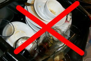 Dishwasher repair solves the problem of having to wash a sink full of dirty dishes - the image shown here.
